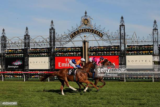 Jockey Michael Rodd riding Rich Enuff crosses the line to win race six Danehill Stakes during Sofitel Girls Day Out at Flemington Racecourse on...