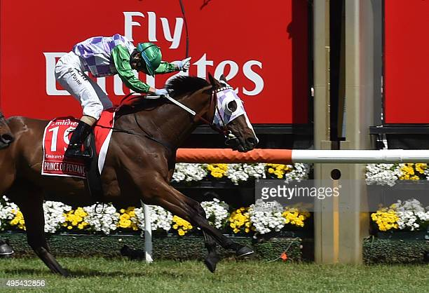Jockey Michelle Payne of Australia crosses the line on Prince of Penzance to become the first female jockey to win a Melbourne Cup at Flemington...