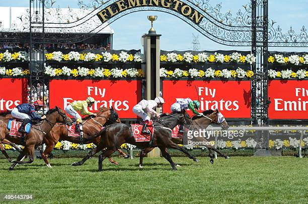 Jockey Michelle Payne right races Prince of Penzance across the finish line during the Melbourne Cup race at the Flemington racecourse in Melbourne...