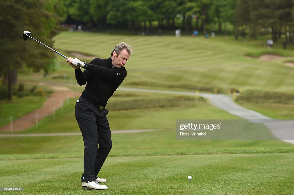 Jockey Mick Fiztgerald tees off during the Pro-Am prior to the BMW PGA Championship at Wentworth on May 25, 2016 in Virginia Water, England.
