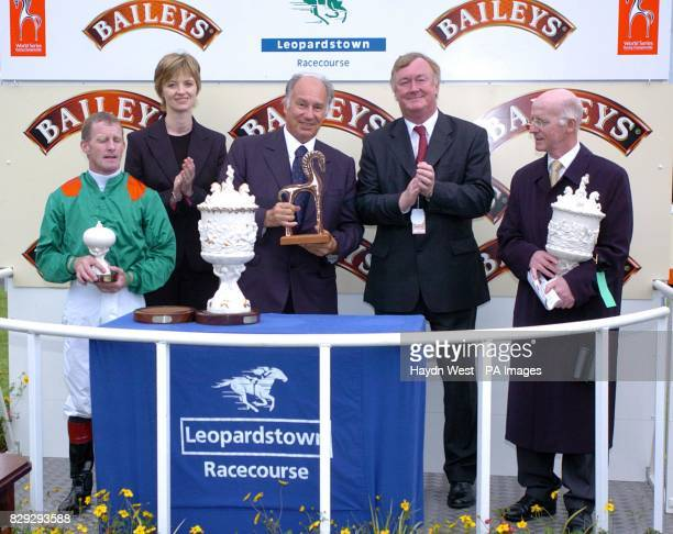 jockey Mick Kinane an unidentified woman His Highness Aga Khan Minister for Sport and Tourism John O'Donoghue who presented the trophy and the...