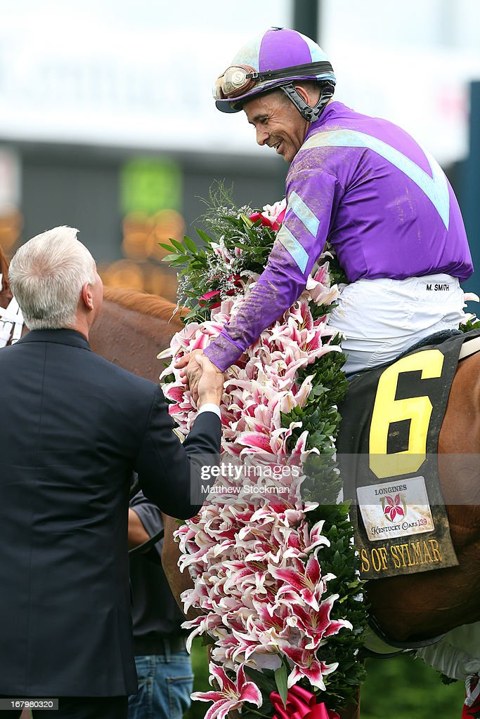 Jockey Mike Smith, atop Princess of Sylamar, celebrates after winning the 139th running of the Kentucky Oaks at Churchill Downs on May 3, 2013 in Louisville, Kentucky.
