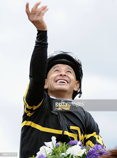 Jockey Mike Smith celebrates atop Judy the Beauty after winning the 2014 DraftKings Breeders' Cup Filly and Mare Sprint at Santa Anita Park on...