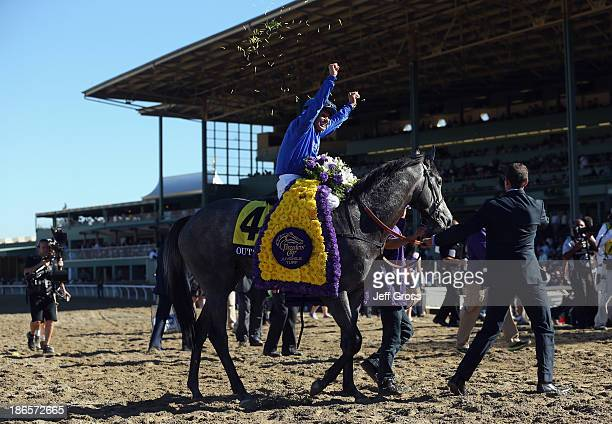 Jockey Mike Smith celebrates atop Outstrip after winning the Juvenile Turf during the 2013 Breeders' Cup World Championships at Santa Anita Park on...