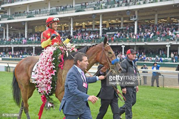 Jockey Mike Smith rides Abel Tasman to win the 143rd running of The Kentucky Oaks at Churchill Downs on May 5 2017 in Louisville Kentucky