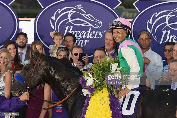 Jockey Mike Smith riding Arrogate celebrates after winning the Breeders' Cup Classic race on day two of the 2016 Breeders' Cup World Championships at...