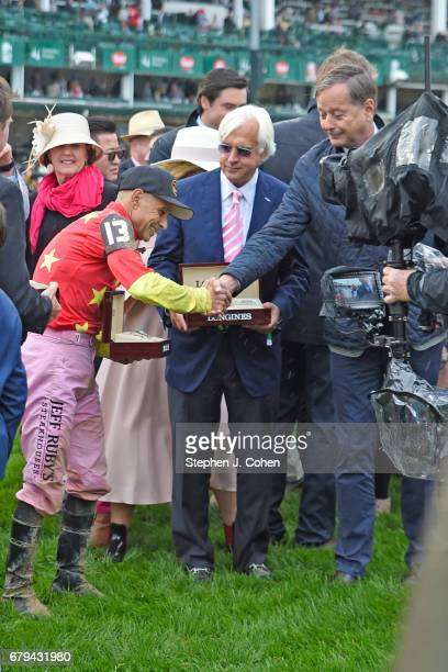 Jockey Mike Smith trainer Bob Baffert Abel Tasman owner Ah Khing Teo and Bernard Cleary attend the 143rd running of The Kentucky Oaks at Churchill...