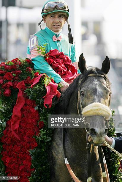 Jockey Mike Smith with the traditional blanket of roses celebrates after winning the 131st Kentucky Derby aboard Giacomo 07 May 2005 at Churchill...