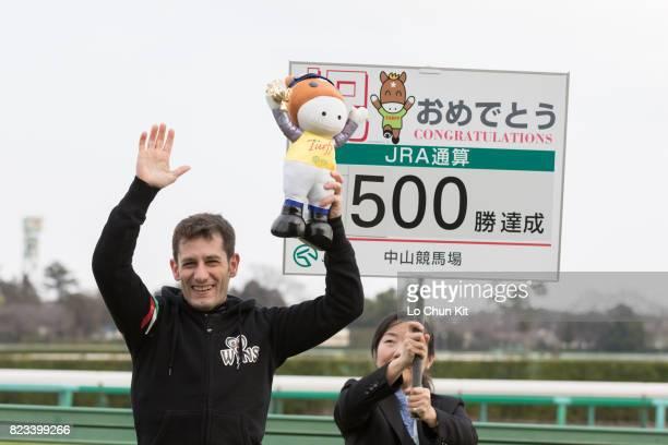 Jockey Mirco Demuro celebrates his 500th JRA victory at Nakayama Racecourse on February 28 2016 in Funabashi Chiba Japan Mirco Demuro kicking off his...