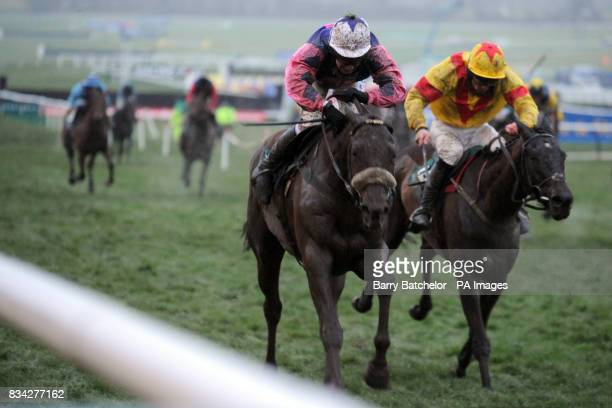 Jockey Miss Nina Carberry on Corskeagh Royale and Jockey Davy Russell on Zaarito battle for second place in the Weatherbys Champion Bumper during the...