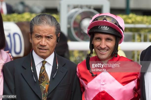 Jockey Neil Callan and trainer Tony Cruz celebrate after Regency Bo Bo winning Race 2 L'oreal Paris Handicap at Sha Tin racecourse on November 6 2016...