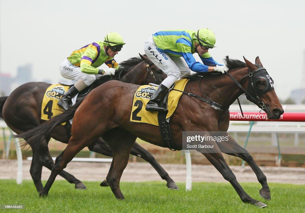 Jockey Nicholas Hall riding Churchill Dancer wins race 3 VOBIS Gold Ingot during Melbourne Racing at Flemington Racecourse on April 13, 2013 in Melbourne, Australia.