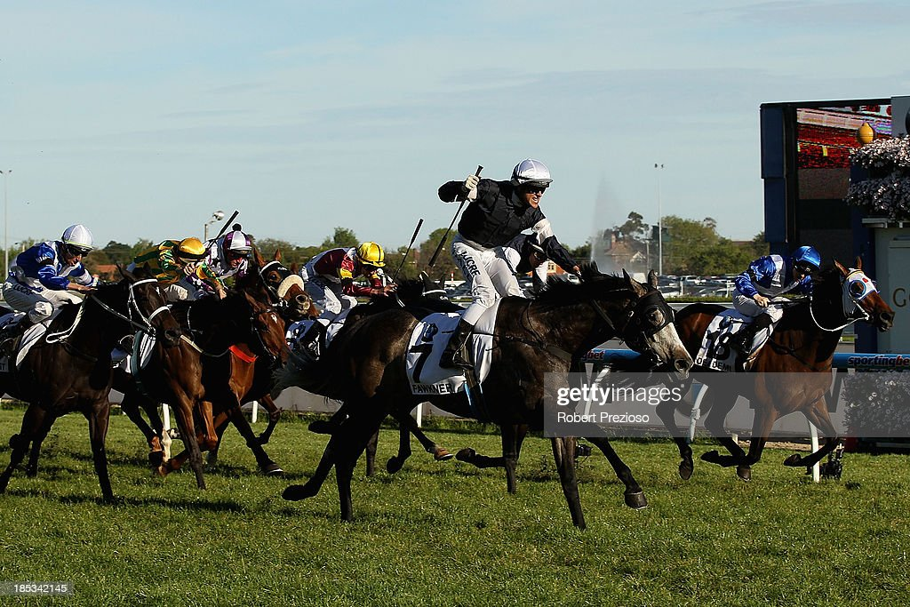 Jockey Nicholas Hall riding Fawkner celebrates crossing the line to win Race 10 the BMW Caulfield Cup during Caulfield Cup day at Caulfield Racecourse on October 19, 2013 in Melbourne, Australia.