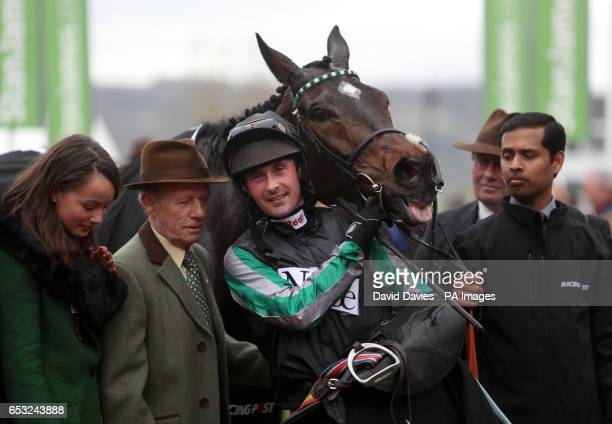 Jockey Nico De Boinville and Altior celebrate winning the 1410 Racing Post Arkle Challenge Trophy Novices' Chase during Champion Day of the 2017...