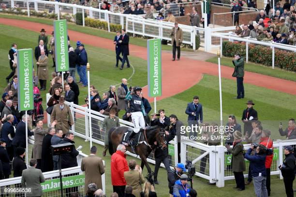 Jockey Nico de Boinville celebrates on board Altior after victory in the Sky Bet Supreme Novices' Hurdle during Champion Day of the 2016 Cheltenham...