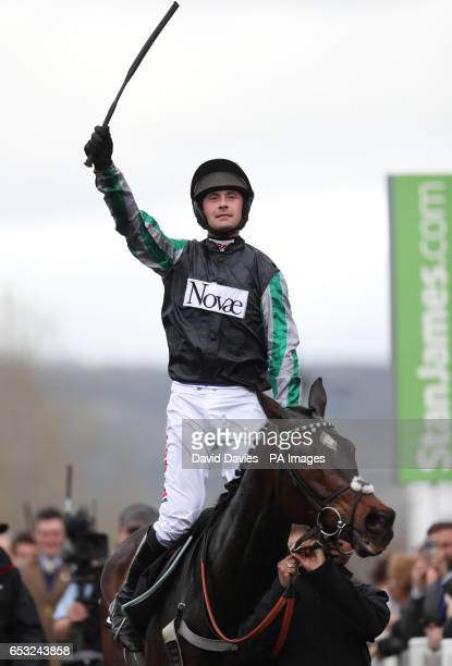 Jockey Nico De Boinville on board Altior celebrates winning the 1410 Racing Post Arkle Challenge Trophy Novices' Chase during Champion Day of the...