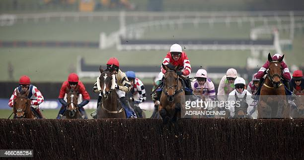 Jockey Nico de Boinville riding Coneygree jumps a fence on his way to winning the Cheltenham Gold Cup on the final day of the Cheltenham Festival...