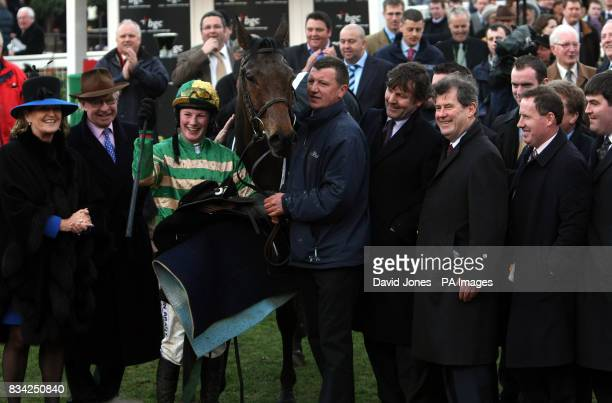 Jockey Nina Carberry with Garde Champetre owned by Ireland's JP McManus after winning the BGC Handicap Steeple during the Cheltenham Festival at...