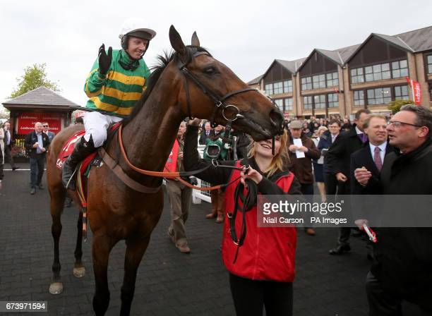 Jockey Noel Fehily and Unowhatimeanharry take the applause after winning The Ladbrokes Champion Stayers Hurdle during day three of the Punchestown...