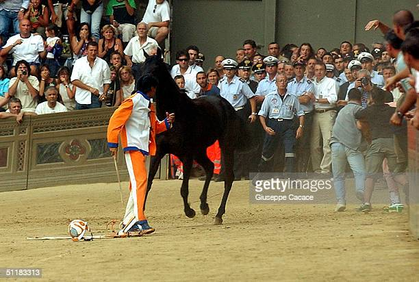 Jockey of the Leocorno falls off in Piazza del Campo during the Palio horse race on August 16 2004 in Siena Italy The city's 17 separate Contrade or...