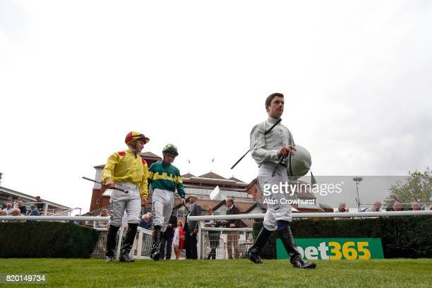 Jockey Oisin Murphy enters the parade ring before riding Mildenberger to victory at Newbury racecourse on July 21 2017 in Newbury England