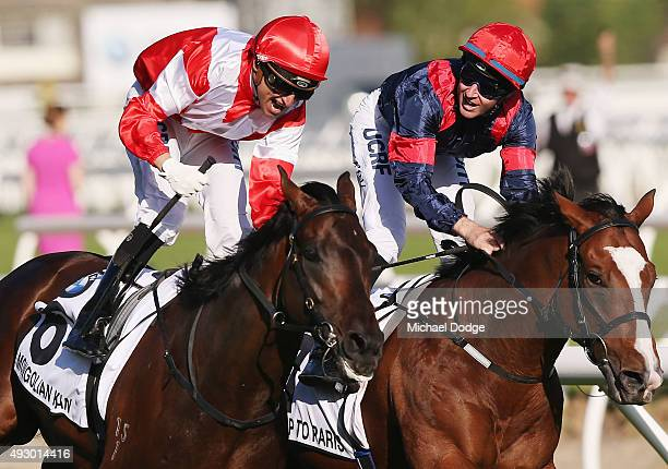Jockey Opie Bosson riding Mongolian Khan wins ahead of Tommy Berry on Trip To Paris in race 9 the BMW the Caulfield Cup during Caulfield Cup Day at...