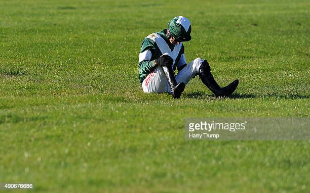 Jockey Paddy Brennan lies on the ground after his fall from Not for you in the Paul's Place handicap steeple chase at Chepstow Racecourse on...