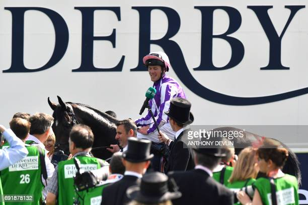 Jockey Padraig Benny celebrates on Wings of Eagles after winning the Epsom Derby on the second day of the Epsom Derby Festival in Surrey southern...