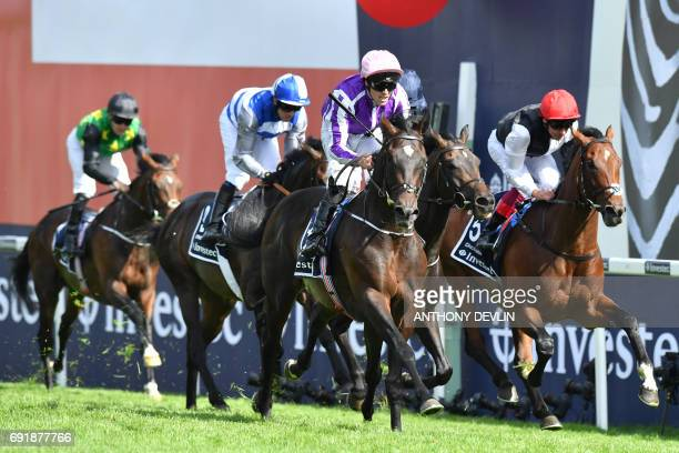 Jockey Padraig Benny rides Wings of Eagles to win the Epsom Derby on the second day of the Epsom Derby Festival in Surrey southern England on June 3...
