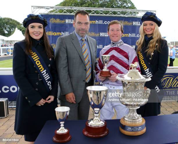 Jockey Pat Crosgrave receives an award after winning the William Hill Ayr Silver Cup