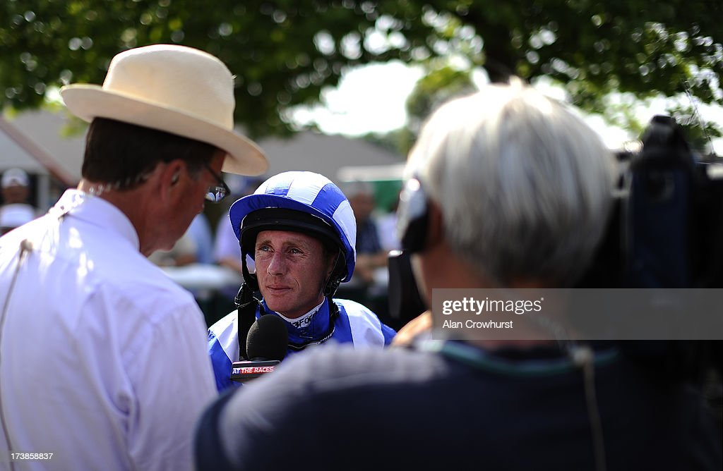 Jockey Paul Hanagan is interviewd by Robert Cooper from At The Races at Leicester racecourse on July 18, 2013 in Leicester, England.