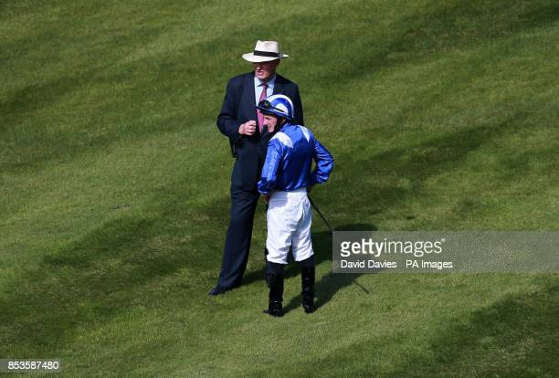 Jockey Paul Hanagan with trainer John Gosden before the Investec Oaks during Investec Ladies Day at Epsom Downs Racecourse Surrey