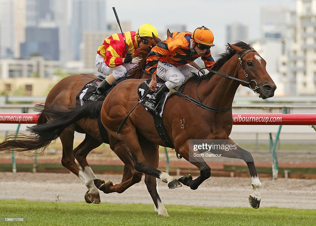 Jockey Peter Mertens rides Over Quota to win race 5 the Comedy King Handicap during Chester Manifold Stakes Day at Flemington Racecourse on January 14, 2012 in Melbourne, Australia.