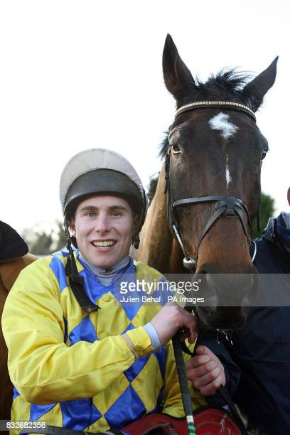 Jockey Philip Enright with Spring the Que after winning the Pierse Hurdle at Leopardstown Racecourse