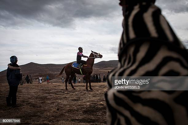 A jockey prepares for the race on July 16 2016 in Semonkong Horseracing in the mountain kingdom of Lesotho is not like at Ascot or Longchamp but it...