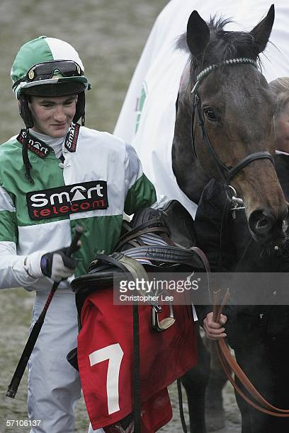 Jockey R Harding with horse Hot Weld poses for the media after he wins The Letheby and Christopher National Hunt Steeple Chase Challenge Cup during...