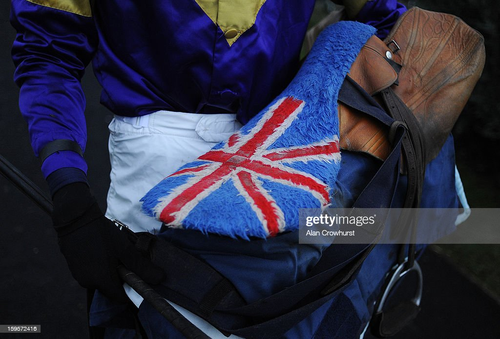 A jockey returns with his Union Jack saddle at Newbury racecourse on January 16, 2013 in Newbury, England.