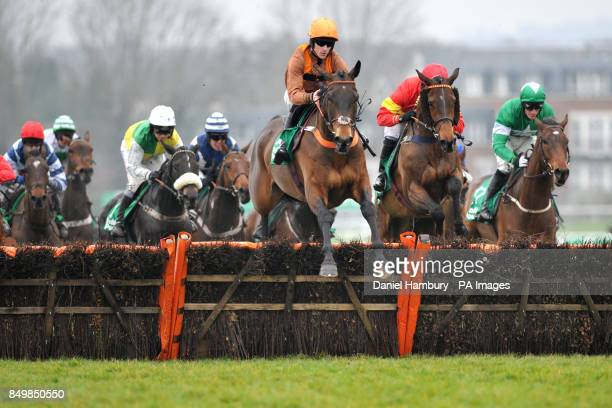 Jockey Richard Hughes on King of the Wolds leads the European Breeders' Fund paddypowercom 'National Hunt' Novices' Handicap Hurdle Final at the...