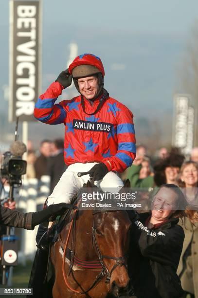 Jockey Richard Johnson celebrates on Balthazar King after victory in the Glenfarclas Handicap Chase on Ladies Day during the Cheltenham Festival