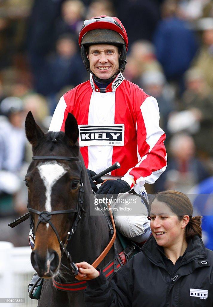 Jockey Richard Johnson rides Monbeg Dude (owned by Zara Phillips's husband Mike Tindall) around the parade ring before running in the Murphy Group Handicap Steeple Chase at Cheltenham Racecourse on November 16, 2013 in Cheltenham, England.