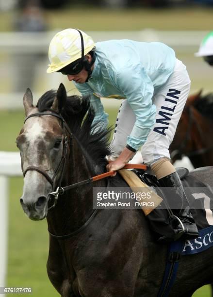 Jockey Richard Moore on Glass Harmonium during the Hampton Court Stakes