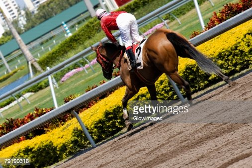 Jockey riding a horse in a horse race : Stock Photo
