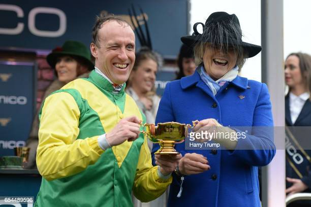 Jockey Robbie Power and Trainer Jessica Harrington hold up the Gold cup after victory on Sizing John during Gold Cup Day of the Cheltenham Festival...