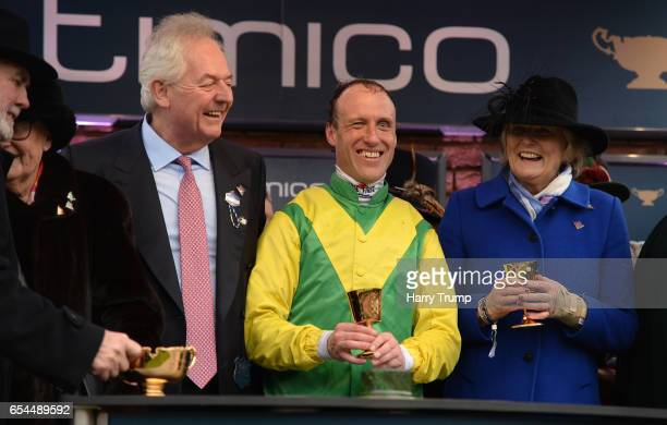 Jockey Robbie Power and Trainer Jessica Harrington smile after winning the Gold Cup on Sizing John during Gold Cup Day of the Cheltenham Festival at...
