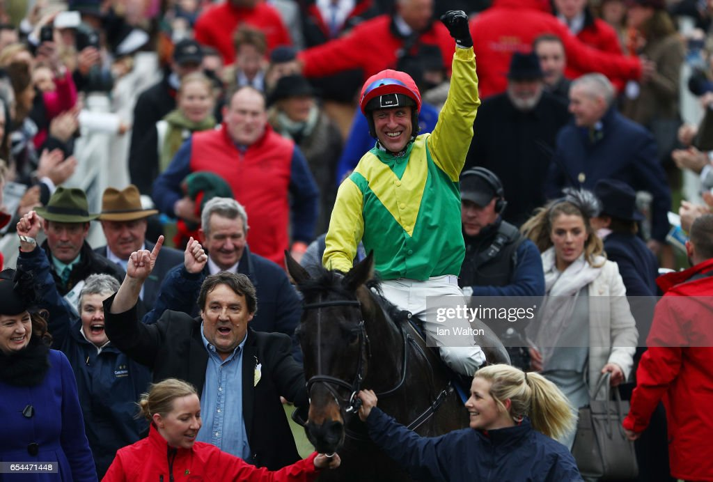 Jockey Robbie Power celebrates after steering Sizing John to victory in the Timico Cheltenham Gold Cup Chase during Gold Cup Day on day four of the Cheltenham Festival at Cheltenham Racecourse on March 17, 2017 in Cheltenham, England.