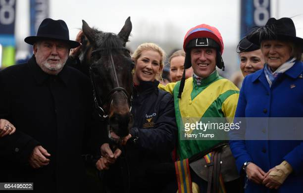 Jockey Robbie Power poses with SIzing John after winning the Gold Cup during Gold Cup Day of the Cheltenham Festival at Cheltenham Racecourse on...