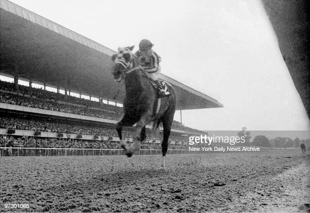 Jockey Ron Turcotte could use a telescope to see Twice A Prince 31 lengths back as he brings Secretariat home for the Triple Crown at the 105th...