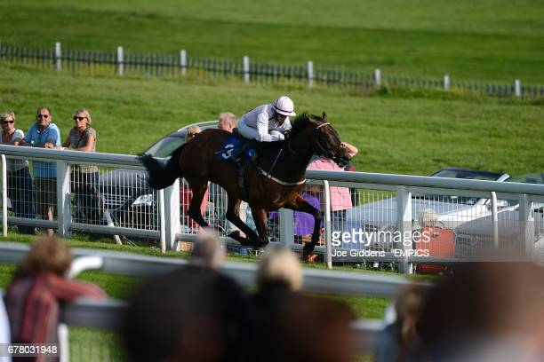Jockey Rosie Jessop on Colinca's Lad on the way to winning the Download Epsom's Android Or iPhone App Handicap
