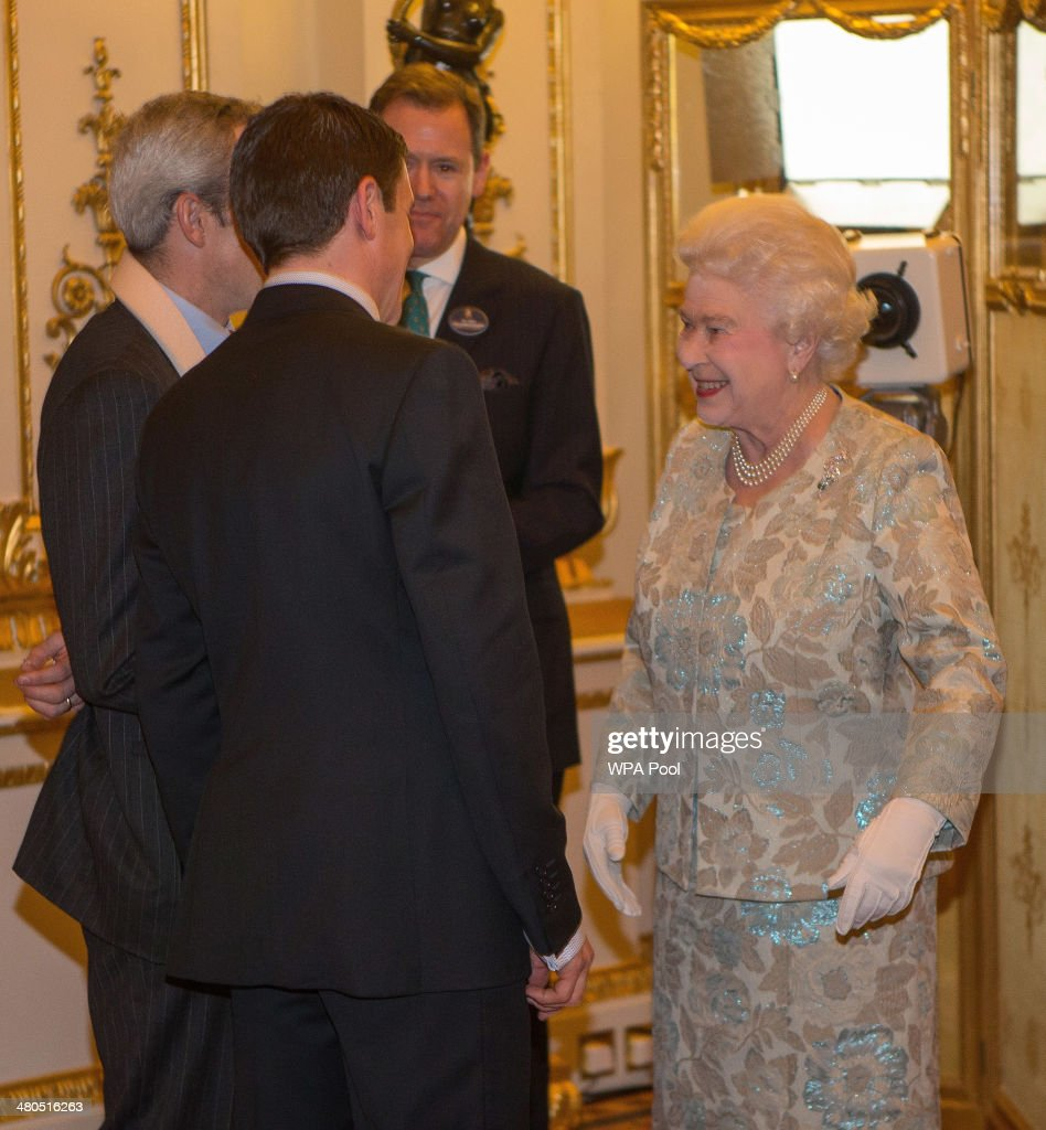 Jockey Ruby Walsh (L) and former professional boxer Barry Geraghty (C) meet Queen Elizabeth II at the Irish Community Reception at Buckingham Palace on March, 25, 2014. The reception is in a advance of Ireland's President Michael D Higgins who will be the first Irish President to pay a state visit to Britain in April.