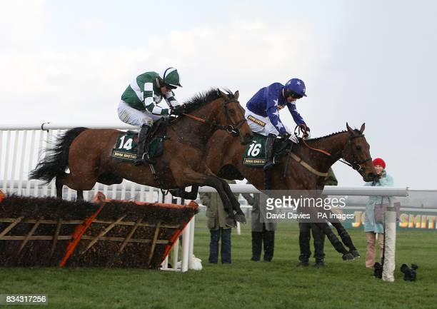Jockey Ruby Walsh on Forest Pennent jumps ahead of Jockey W Kennedy on Superior Wisdom to go on to win the John Smith's Extra Cold Handicap Hurdle at...